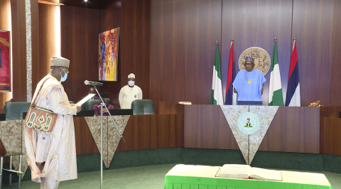 Buhari Swears in Prof Yakubu for a Second Tenure as INEC Chairman