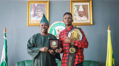 Israel Adesanya presents gold belt to Amosun