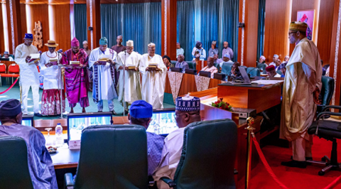 Buhari Swears-in Lawan's Aide, 11 Others as NASS Service Commission