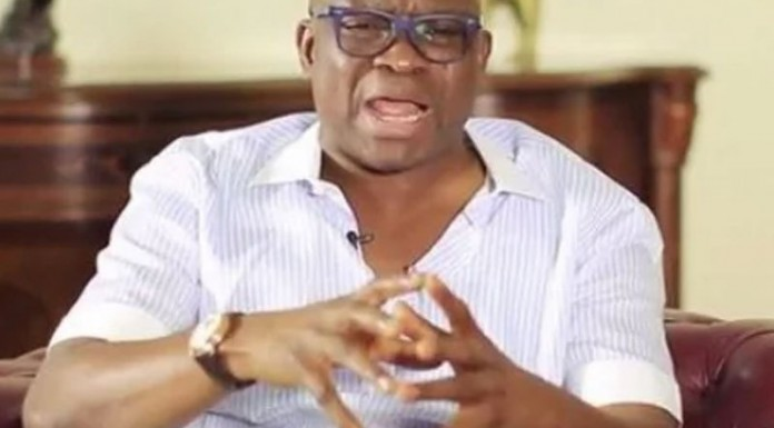 Fayose challenges Fayemi to settle workers' salaries