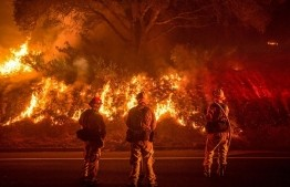 At least 23 dead, as winds fan California wildfires
