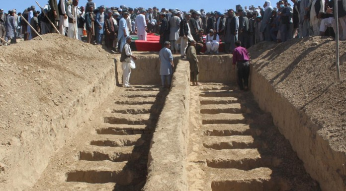 Afghan police discover mass graves in village