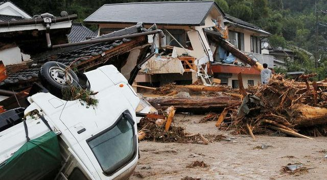 At least 11 missing as heavy rain pounds Japan