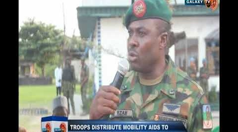 Troops distributes mobility aids to persons with disabilities